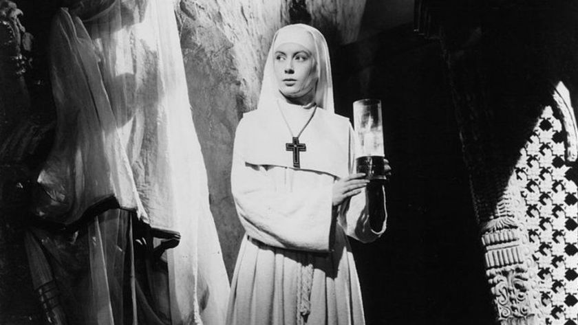 Deborah Kerr holds a candle in a scene from the film 'Black Narcissus', 1947. (Photo by Universal Pictures/Getty Images)