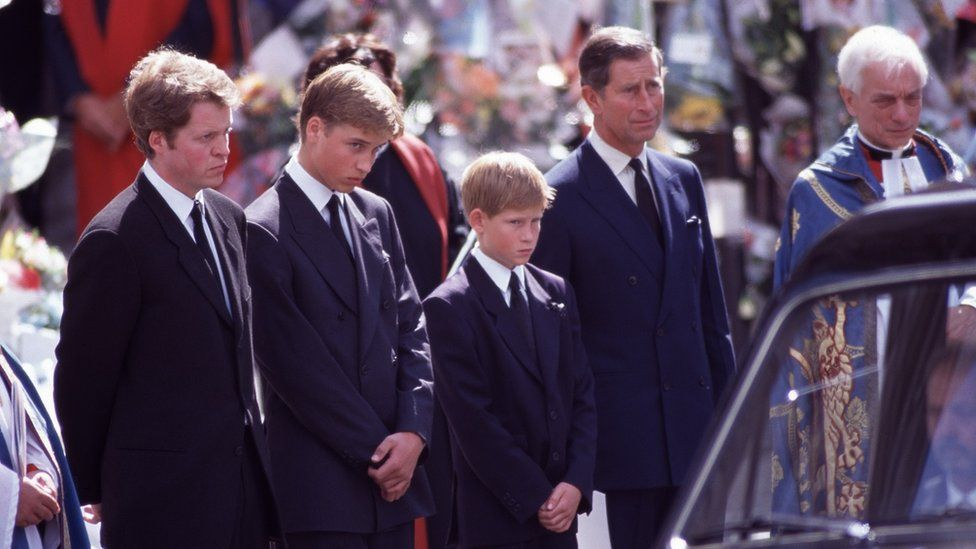 Prince Harry and his family standing beside his mum's hearse at her funeral