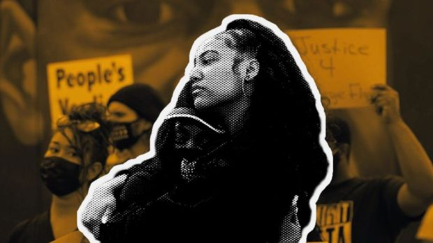 Two black women hugging in the street after the Derek Chauvin verdict was announced