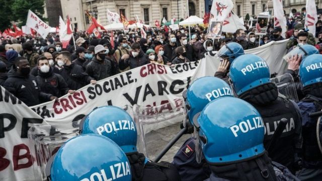 Labour activists face police as they take part in a protest on May Day or International Workers' Day in Turin, Italy