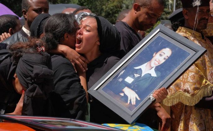 A woman cries over the coffin of her loved one during a memorial service for the Ethiopian passengers and crew who perished in the Ethiopian Airways ET302 crash - March 2019