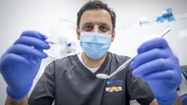 Scottish Labour leader Anas Sarwar, who began his working life for the NHS as a dentist, during a visit to the Complete Dental Care surgery in Glasgow ahead of the first Scottish party leaders' debate to discuss Labour's plan for an NHS recovery. Picture date: Tuesday March 30, 2021.