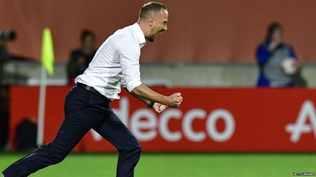 England manager Mark Sampson celebrates after the game