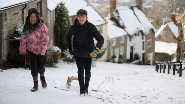 People sledging on Gold Hill in Shaftesbury Dorset - Andrew Matthews PA Wire