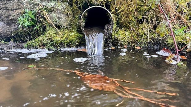 Pipe carrying water into river
