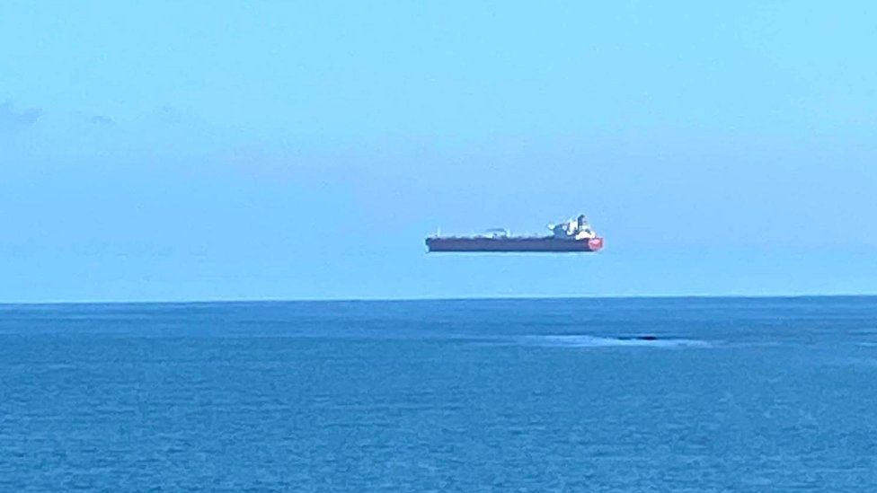 Hovering ship pictured off the coast of Cornwall