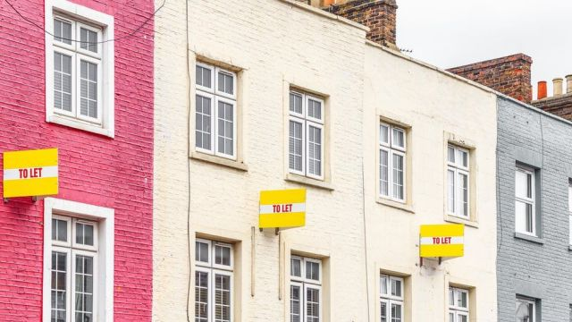 Houses with To Let signs on their walls