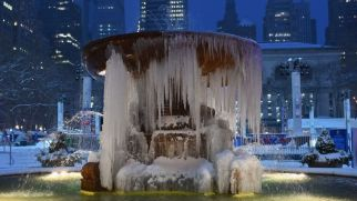 The Josephine Shaw Lowell Memorial Fountain is seen covered in ice during a winter storm on February 1, 2021 in New York City.