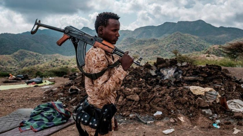 A member of the Afar Special Forces stands in front of the debris of a house in the outskirts of the village of Bisober, Tigray Region, Ethiopia, on December 09, 2020.Several houses in the village were damaged during the confrontations between the Tigray Forces and the Ethiopian Defense Forces.