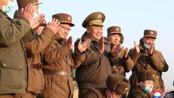 North Korean military staff clapping