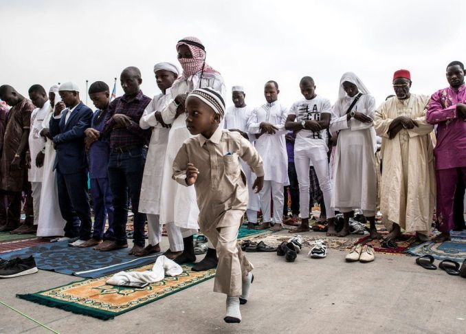 A young Muslim worshipper runs off during a mass prayer to celebrate Eid al-Fitr at the Stade des Martyrs in Kinshasa, DR Congo - 4 June 2019