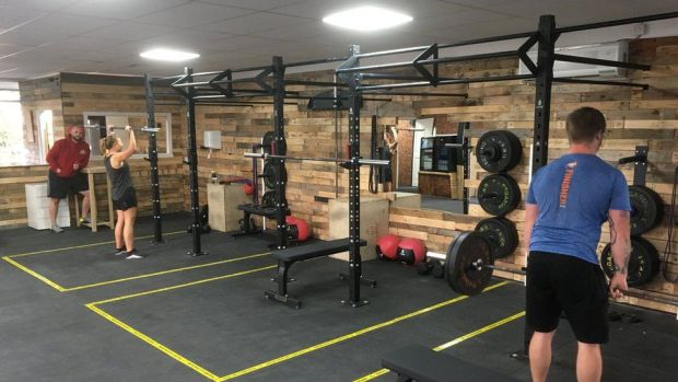 People working out in a socially distanced gym
