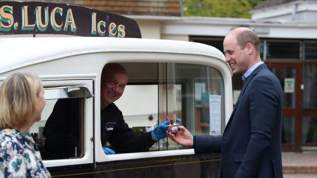 Prince William receives ice cream during a visit to the Queen's Bay Lodge Care Home