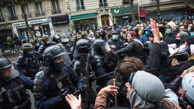 French anti riot Police forces face protesters as clashes erupt during the annual May Day march in Paris