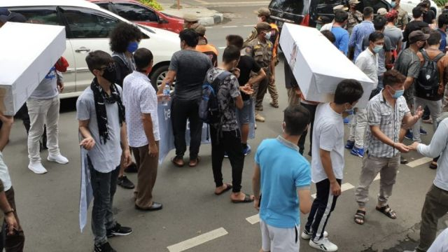 Refugees at a protest in Jakarta, Indonesia, carry coffins