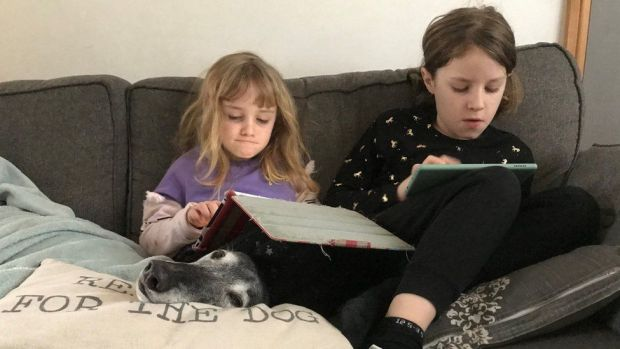 Mollie and Nell doing their school work