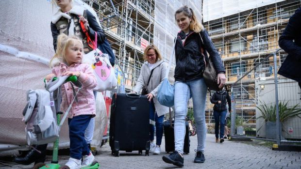 Family leaving an apartment block in Essex following an investigation into fire and safety issues