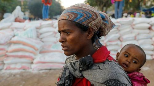 Woman queues for food at a temporary shelter in Tigray (file pic - March 2021)