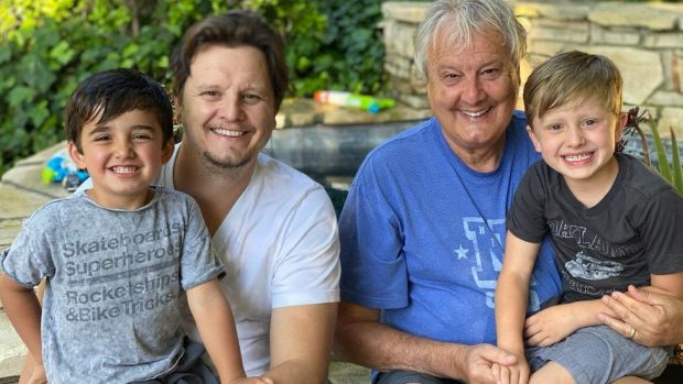 Mike Young (right) with son Pete, with Mike's grandsons Bodhi and Owen