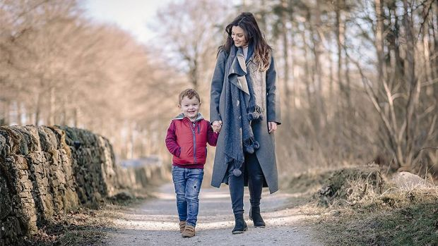 Kelly walking with her son Finnlay