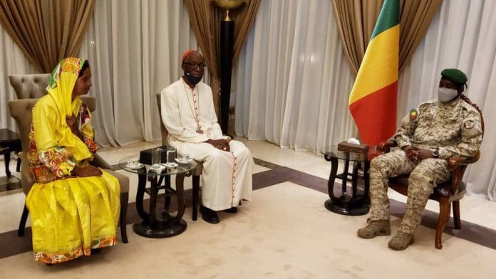 Ms Narváez and Colonel Assimi Goita and the archbishop of Bamako Jean Zerbo.