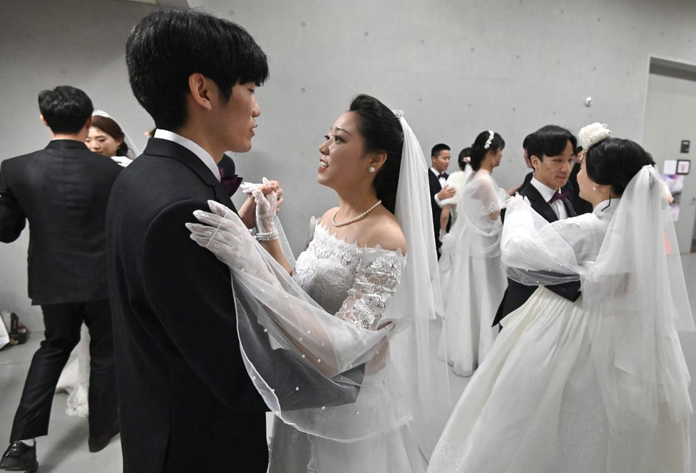 Couples prepare for their performances at a mass wedding ceremony organised by the Unification Church in Gapyeong.