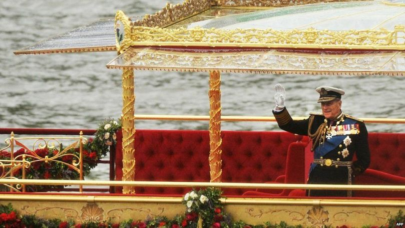 Prince Philip, Duke of Edinburgh, waves as he stand onboard the Spirit of Chartwell during the Thames Diamond Jubilee Pageant