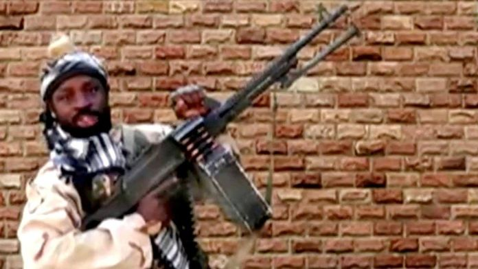 Boko Haram leader Abubakar Shekau holds a weapon in an unknown location in Nigeria