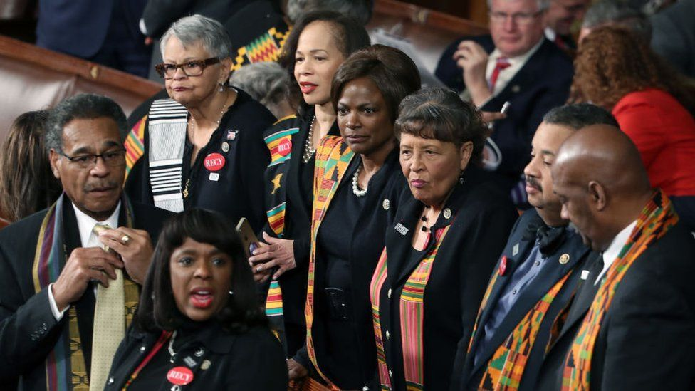 Members of Congress wear black clothing and Kente cloth in protest before the State of the Union address in the chamber of the U.S. House of Representatives January 30, 2018