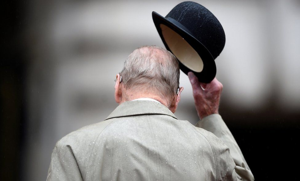 Britain's Prince Philip pictured from behind as he doffs his hat on 2 August, 2017.
