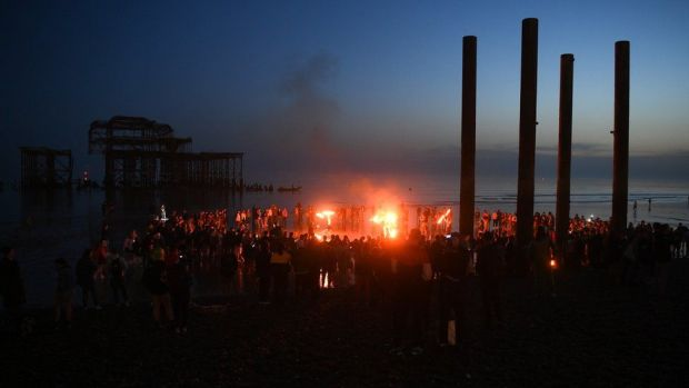 Fire performers attract crowds as night falls on Brighton beach