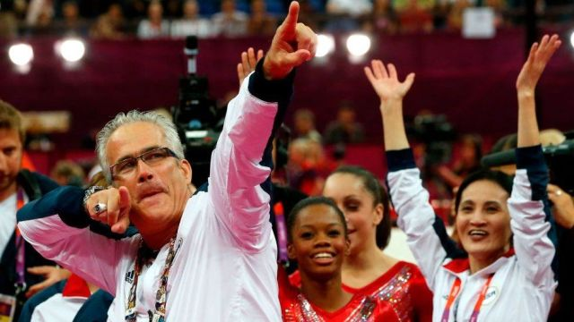 John Geddert celebrates with the US Olympic gymnast team at the London Games in 2012