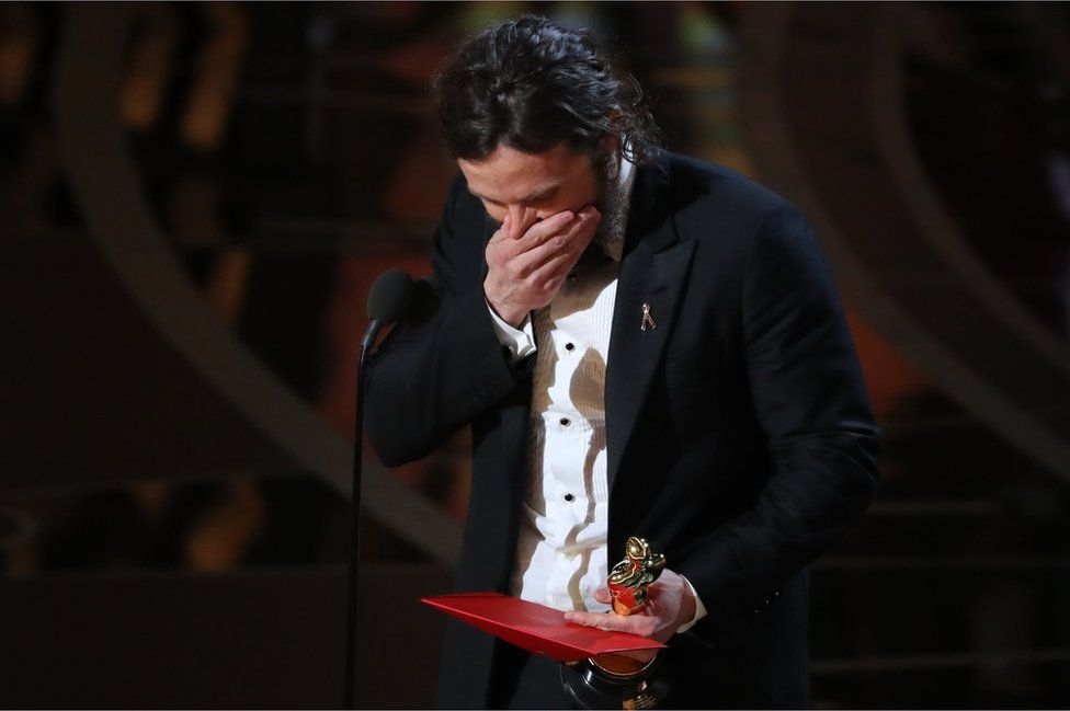 Casey Affleck reacts as he accepts the Oscar for Best Actor