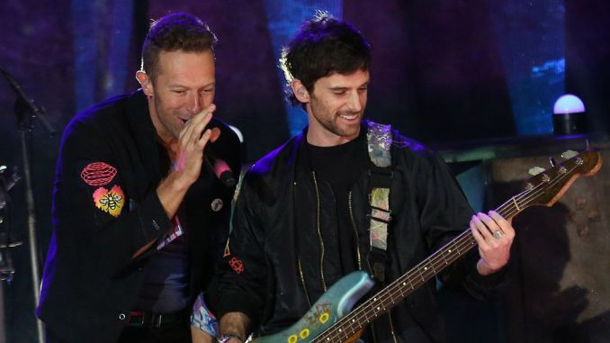 Chris Martin and Guy Berryman of Coldplay on stage in London in October 2021