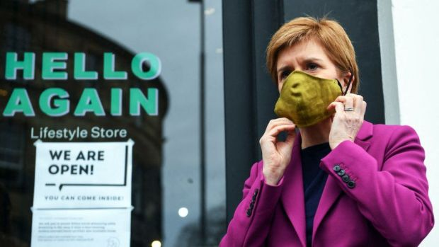 Nicola Sturgeon outside a shop
