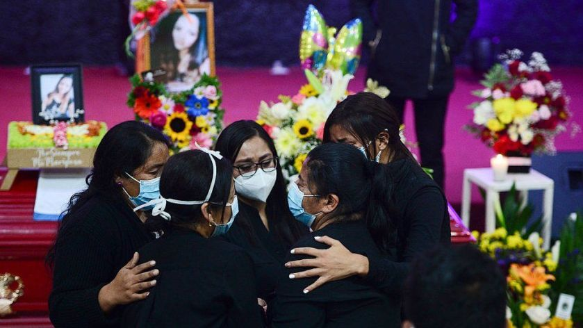 Nurse Keyla Martinez's sister is hugged by family as she mourns by her coffin during her funeral in La Esperanza, Honduras, on February 9, 2021.