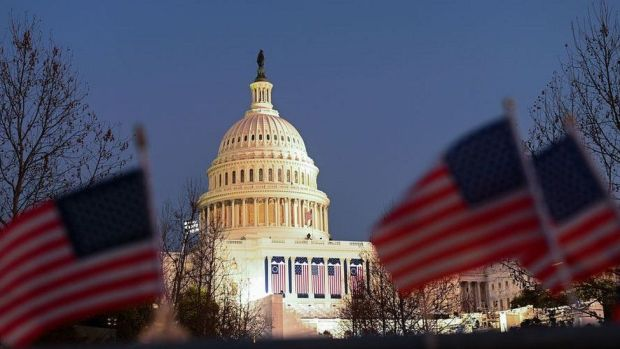 US flags can be seen near the Capitol Building in Washington, DC on January 19, 2021