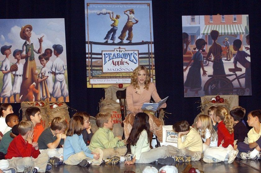 Madonna reads her new book 'Mr. Peabody's Apples' to students at Montclair Kimberly Academy on November 11, 2003 in Montclair, New Jersey