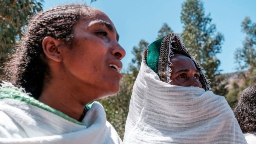 Women mourn the victims of a massacre allegedly perpetrated by Eritrean Soldiers in the village of Dengolat, North of Mekele, the capital of Tigray on February 26, 2021