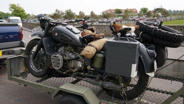A replica SS motor bike arrives at Bamburgh Castle