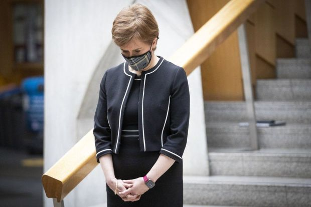 Nicola Sturgeon bows her head during a minute's silence
