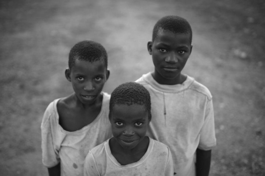 Three boys smile for the camera.