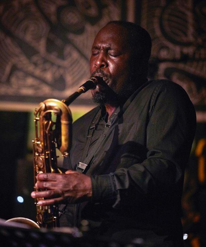Tony Kofi performing
