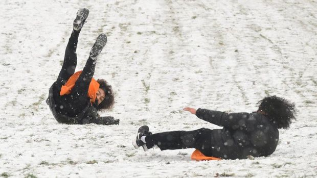 People sledging in Greenwich, south-east London