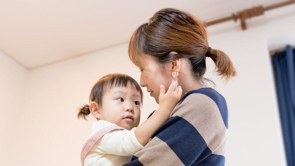 Mulher com a filha