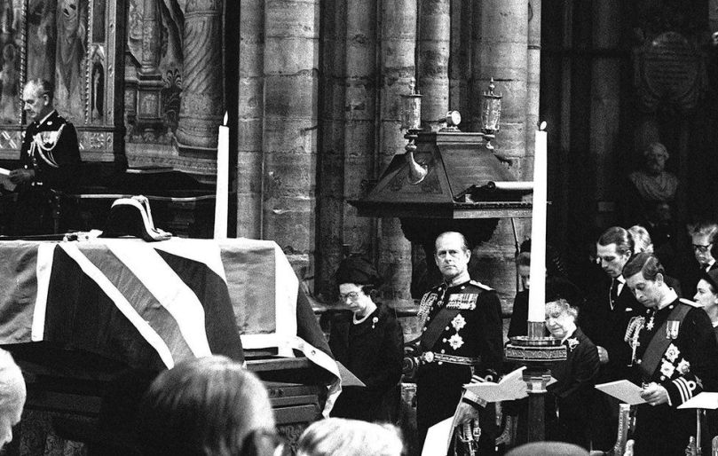 The Union flag-draped coffin of Lord Mountbatten rests on a catafalque during the funeral service in Westminster Abbey. Royal mourners (l/r) Queen Elizabeth II, her husband The Duke of Edinburgh, Queen Elizabeth The Queen Mother and the Prince of Wales, 5 September 1979