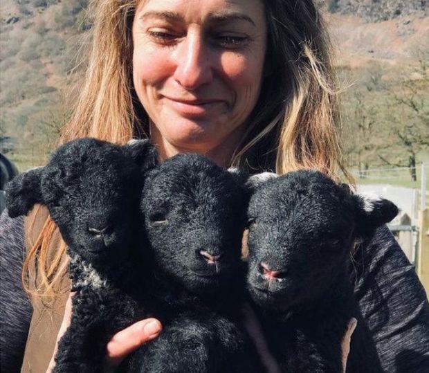 Jo holding three lambs