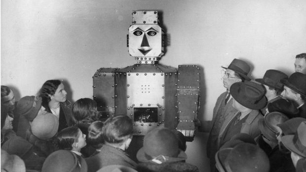 Children stand admiring a fortune-telling robot at Selfridges