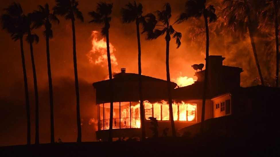 A house burns during the Woolsey Fire on November 9, 2018 in Malibu, California