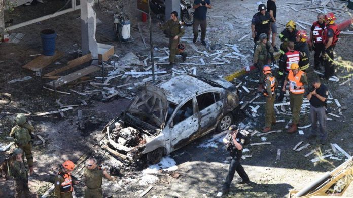Police and rescue teams at the scene of a direct rocket hit in Ramat Gan, Israel, May 15, 2021